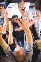 Creative business people cheering in office photo