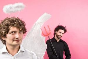 white angel with curly blond hair and devil on background