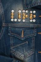 Word life made of rhinestones on denim jacket photo