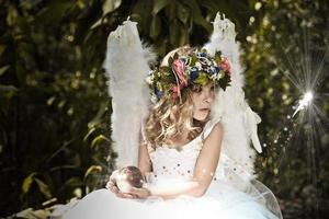 Fairy in an enchanted forest photo