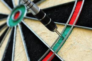 close up of dart and dartboard