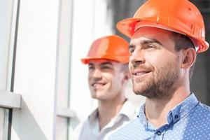Attractive builders are dreaming about future development of building photo