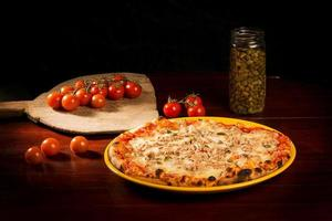 Cheese pizza with meat and vegetables