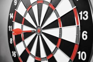 Dartboard with red darts photo