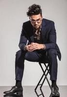 business man sitting on chair and looking down photo