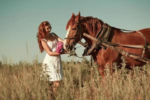 Woman and horse in summer day, outdoors. Series