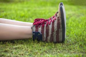Female in sneakers with the design of the American flag
