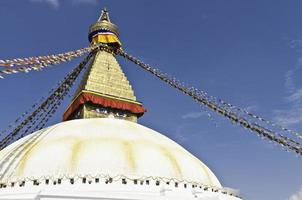 Golden stupa shrine colorful buddhist prayer flags Bodnath Kathmandu Nepal photo