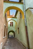 Ancient alley with arches in sighisoara, Romania.