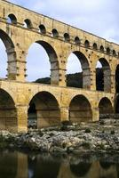 Roman aqueduct at Pont du Gard, France photo