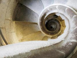 Spiral staircase of white stone