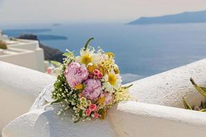 Wedding bouquet on a background of the sea photo