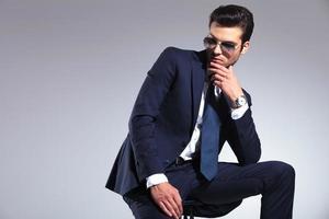 Elegant business man looking down photo