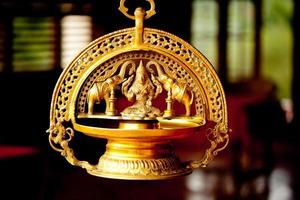 Gold indian goddess and two elephant sculpture photo