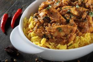 chicken balti curry on white background photo