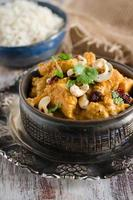 Chicken curry with cashew nuts and cranberries photo