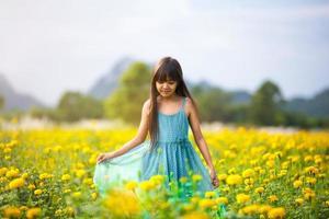 Little asian girl in flower fields photo