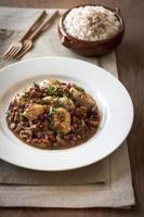 Chicken and pomegranate curry photo