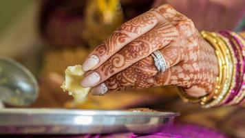 Indian bride's hands eating