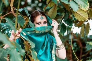 The girl in the blue Indian costume. photo