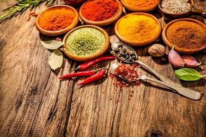 Herbs and spices on wooden table photo
