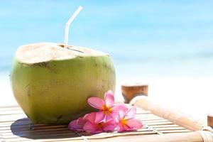 Tropical fresh cocktail on white beach photo