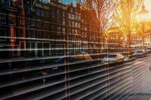 Beautiful night in Amsterdam. Night illumination of buildings an photo