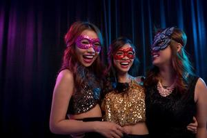 Girls in masquerade masks photo