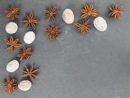 star anise and nutmeg on a black slate