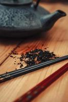 Tea, teapot and chopsticks photo