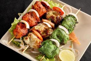Kebab Platter are small pieces of meat on skewers photo