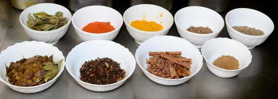 Food condiments in round dishes.