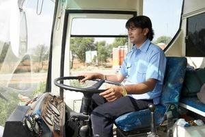 Asian bus driver in action