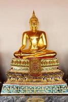 Buddha sculture sitting in meditation photo