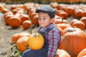 Asian boy playing at pumkin path.