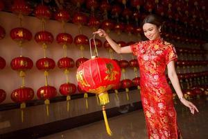 girl in qipao holding lantern