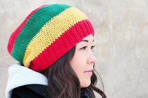 Young Asian girl in rasta cap