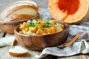 Pumpkin stew with rice and meat photo