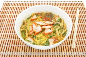 Egg noodle soup with red roast pork photo