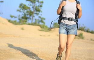woman hiker walking at mountain trail photo