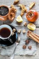 Fruit tea with spices and cookies photo