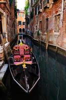 Beautiful gondola boat in the canal of Venice Italy.