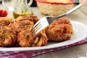Dumplings stuffed cabbage with tomato sauce