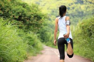 Runner athlete stretching legs