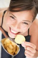 Chips woman eating junk food crips
