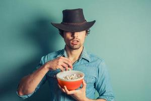 Cowboy eating popcorn photo