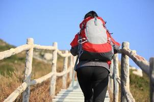 hiking woman climbing mountain stairs photo