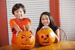 Children with Halloween pumpkins