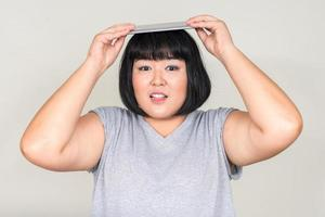 Portrait of beautiful overweight Asian woman photo