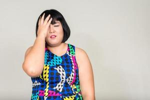 Portrait of stressed overweight Asian woman photo